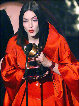 "Madonna accepts her Grammy, in geisha drag, 1999.  Hard to believe that I think of that moment as ""the good old days!"""